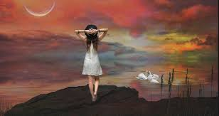 Girl on hill looking out at pretty dream